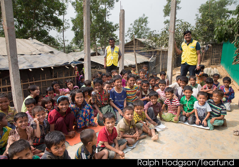 Rohingya children show their thirst for learning by joining one of Tearfund's safe spaces, where they can play, draw, write poems, talk to a trained therapist, do informal maths and sing songs together.